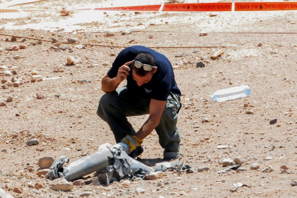 An Israeli police sapper examines exploded remains of a rocket fired at Eilat in April 2013. (Illustrative photo.) Credit: Flash90.