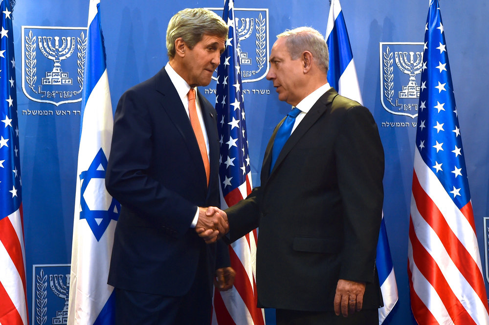 Former U.S. Secretary of State John Kerry (left) shakes hands with Israeli Prime Minister Benjamin Netanyahu in Tel Aviv in July 2014. Citing unidentified former senior Obama administration officials, the Haaretz newspaper reported Sunday that Netanyahu had met with Egyptian and Jordanian heads of state in a secret meeting last year in Jordan, in order to promote a regional peace agreement. Credit: U.S. Department of State.