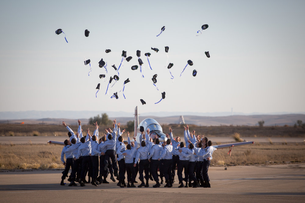Israeli Air Force (IAF) pilots throw their hats at a graduation ceremony for soldiers who completed the IAF flight course at the Hatzerim Air Base in the Negev Dec. 29, 2016. Credit: Miriam Alster/Flash90.
