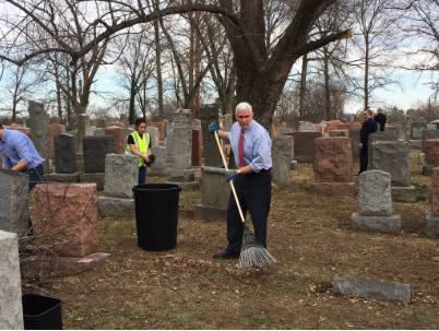 Vice President Mike Pence pitches in on the repair effort at the Chesed Shel Emeth Society cemetery in Missouri. Credit: Gov. Eric Greitens via Twitter.