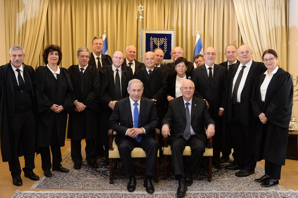 The Supreme Court justices of Israel, with the prime minister and president, in January 2015. Credit: President of Israel's office.