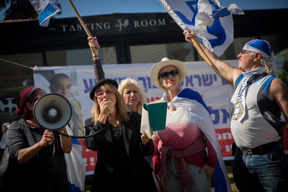 Supporters of convicted Israeli soldier Elor Azaria rally for him outside a military court in Tel Aviv Feb. 21, 2017. Credit: Miriam Alster/Flash90.