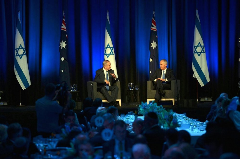 Israeli Prime Minister Benjamin Netanyahu (left) and Australian Prime Minister Malcolm Turnbull on stage at a conference attended by business leaders Feb. 22. Credit: Haim Zach/GPO.