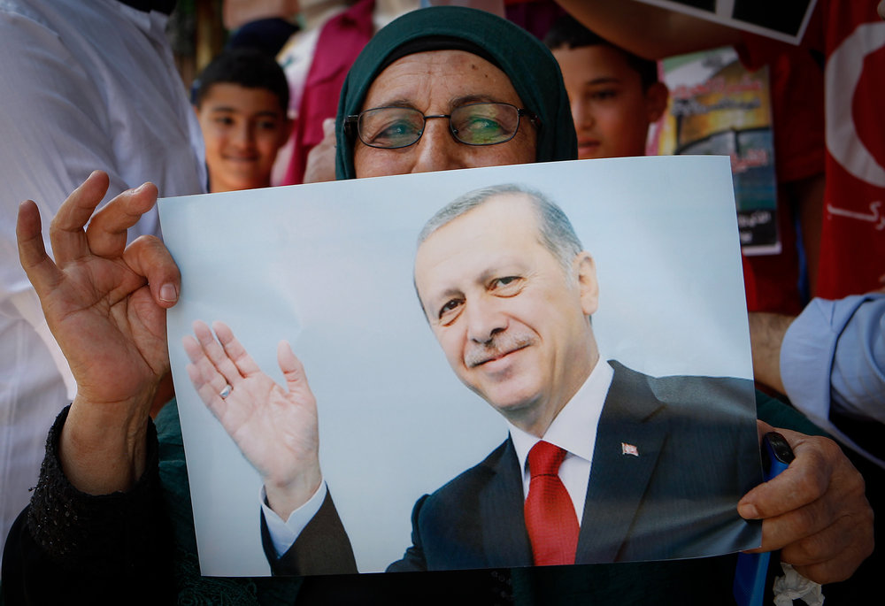 A picture of Turkish President Recep Tayyip Erdogan held by a Palestinian showing solidarity with Turkey against the failed coup in that country in 2016. Credit: Wisam Hashlamoun/FLASH90.