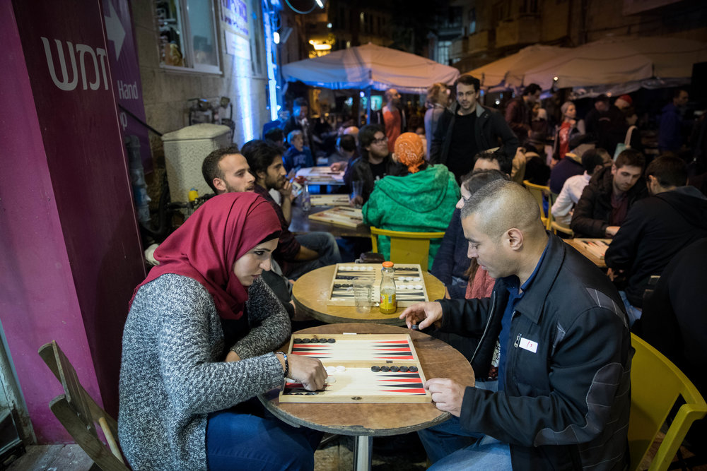 "Jews and Arabs play backgammon during the ""Jerusalem Double"" championship in Jerusalem Feb. 27, 2017. The backgammon competition aims to foster Jewish-Arab coexistence in Israel. Credit: Yonatan Sindel/Flash90."