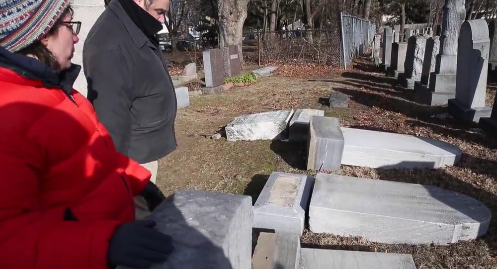 Overturned headstones at the Waad Hakolel Jewish cemetery in Rochester, N.Y. Credit: YouTube screenshot.