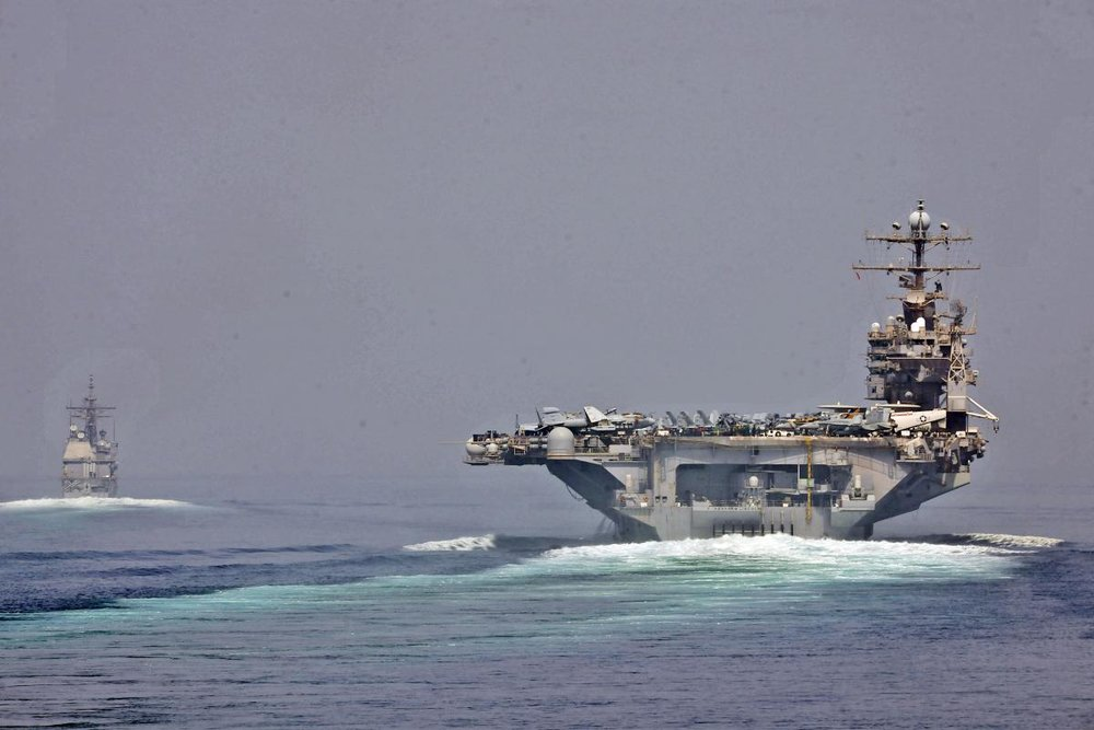 The USS Abraham Lincoln and USS Cape St. George transition through the Strait of Hormuz in May 2012. (Illustrative photo.) Credit: U.S. Navy.