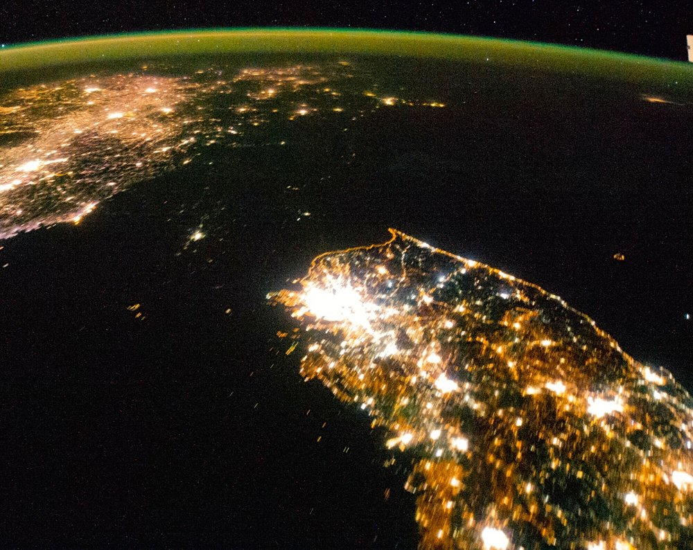 Satellite images like this one illustrate the nature of the North Korean regime, writes columnist Ben Cohen. While South Korea (bottom) sparkles brightly, North Korea (center) is shrouded in pitch black darkness—save for a small glimmer around Pyongyang, the capital, where the officials of the ruling party are quartered, and which is spared, relatively speaking, from the famine and electricity shortages that prevail in the rest of the country. Credit: NASA.