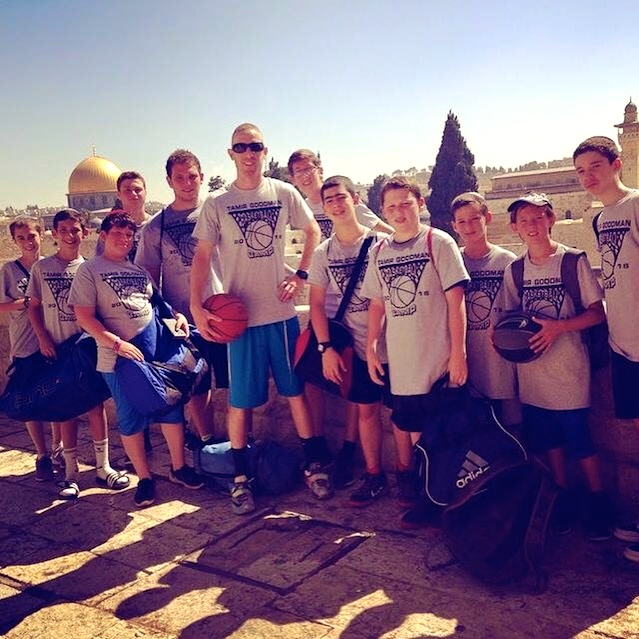 Tamir Goodman (in center, holding basketball) with his summer campers in Jerusalem. Credit: Courtesy of Tamir Goodman.