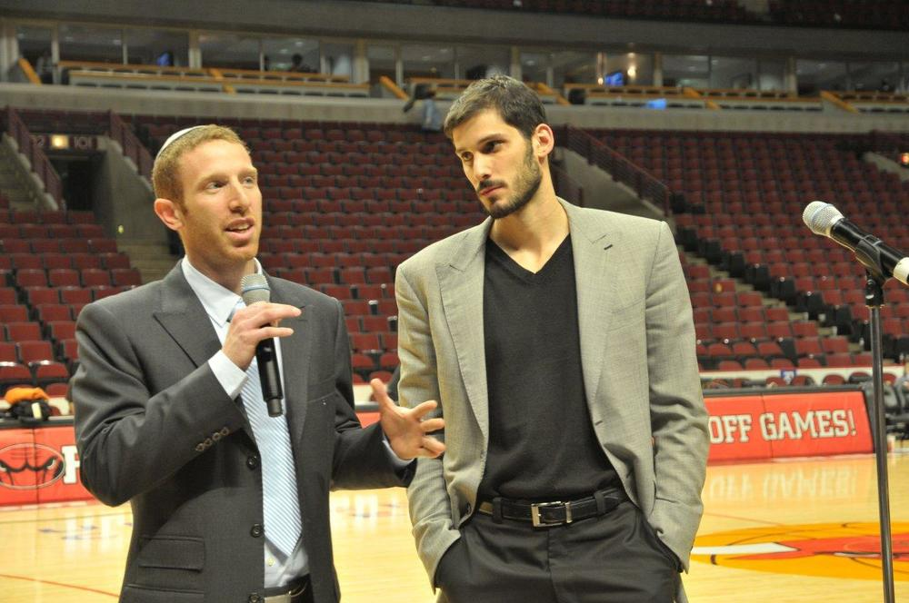 """Jewish Jordan"" Tamir Goodman (left) and Omri Casspi, the first Israeli-born player in National Basketball Association (NBA) history, are pictured on the court of the United Center, home of the NBA's Chicago Bulls. Courtesy Tamir Goodman."
