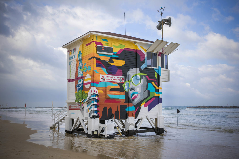 Designers and a graffiti artist transformed this lifeguard tower on a Tel Aviv beach into a high-end hotel suite to attract more beach-going visitors to the area. Credit: Guy Yehieli.