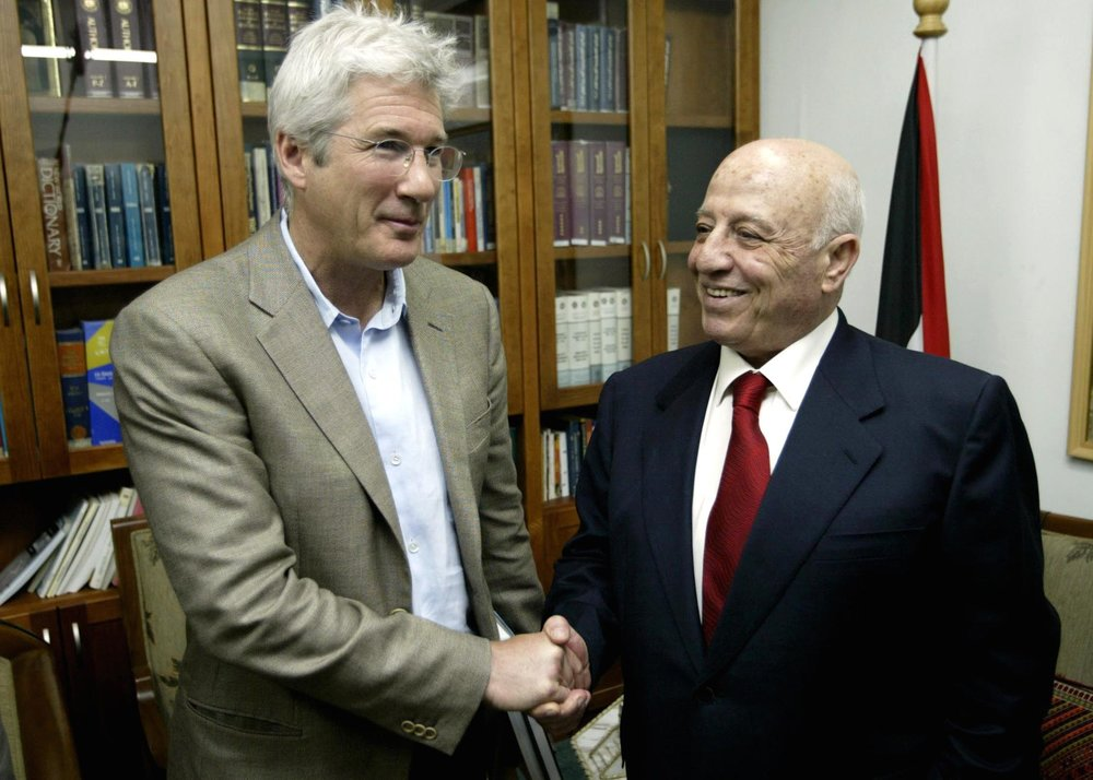Hollywood actor Richard Gere (left) meets with Ahmed Qurei, then the prime minister of the Palestinian Authority, June 5, 2004. Credit: Flash90.