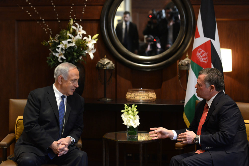 Israeli Prime Minister Benjamin Netanyahu (left) meets with Jordan's King Abdullah at the Royal Palace in Amman Jan. 16, 2014. Credit: Kobi Gideon/GPO/Flash90.