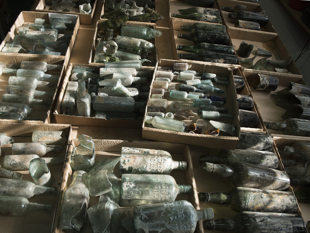 The assemblage of liquor bottles belonging to British soldiers that was revealed in an Israeli excavation. Credit: Clara Amit, courtesy of Israel Antiquities Authority.