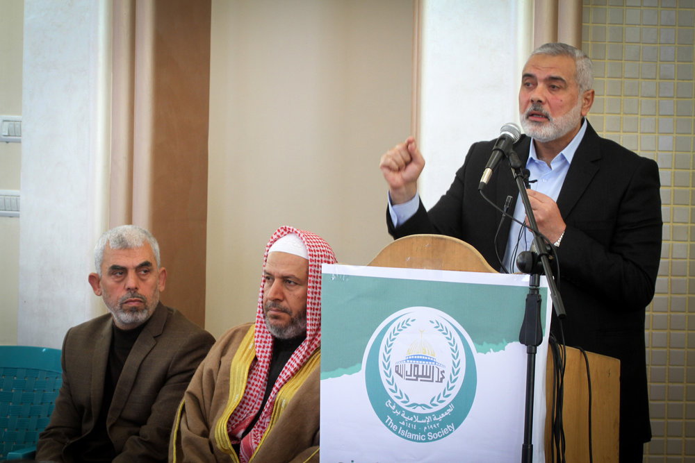 Yahya Sinwar (left), the new leader of Hamas in the Gaza Strip, and senior political leaders of the Islamist terror group Hamas Khalil al-Haya (center) Ismail Haniyeh (at podium) attend the opening of a new mosque in southern Gaza Feb. 24, 2017. Credit: Abed Rahim Khatib/ Flash90.