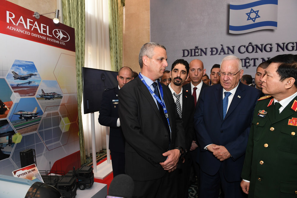 Israeli President Reuven Rivlin (front, second from right) and Defense Minister of Vietnam Ngô Xuân Lịch (front, right) visit an Israeli-Vietnamese defense export exhibition in Hanoi, Vietnam, March 21, 2017. Credit: Kobi Gideon/GPO.