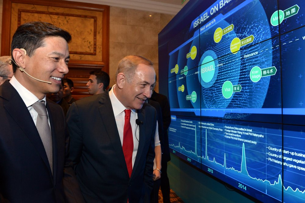 Israeli Prime Minister Benjamin Netanyahu (center) with Chinese internet entrepreneur Robin Li (left) in Beijing March 21. During his trip to China, Netanyahu met with the heads of nearly a dozen of that country's largest corporations about investment in Israel. Credit: Haim Zach/GPO.