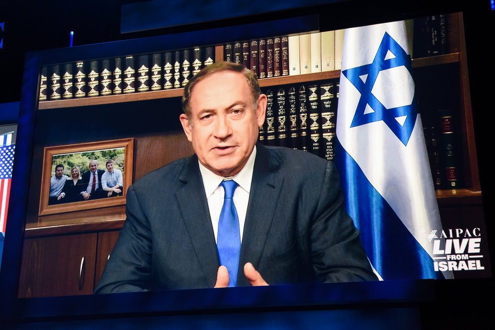 Prime Minister Benjamin Netanyahu addresses the AIPAC conference via satellite Monday. Credit: AIPAC.