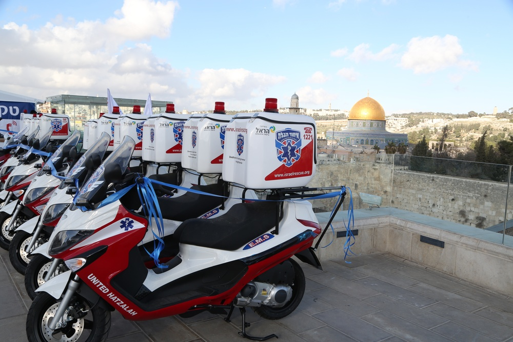 United Hatzalah ambucycles, with a view of the Temple Mount in the background, at a January 2014 event in Jerusalem marking billionaire Stewart Rahr's donation of 50 ambucycles to the Israeli volunteer EMS group. Credit: United Hatzalah.