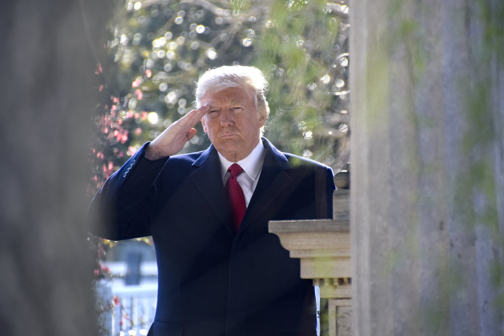 President Donald Trump gives a salute at the gravesite of former President Andrew Jackson. Credit: Tennessee National Guard Public Affairs Office via Wikimedia Commons.