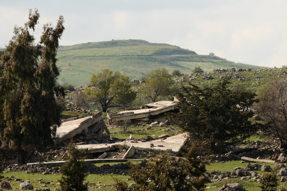 Destroyed buildings in Quneitra, Syria, near the Israeli border. Credit: Ed Brambley via Wikimedia Commons.