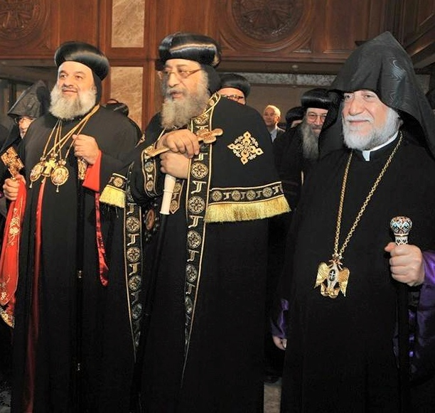 Egypt's Coptic Pope Tawadros II (center) was reportedly inside Alexandria's St. Mark's Coptic Orthodox Cathedral during Sunday's bombing there, but was not injured. Credit: Wikimedia Commons.
