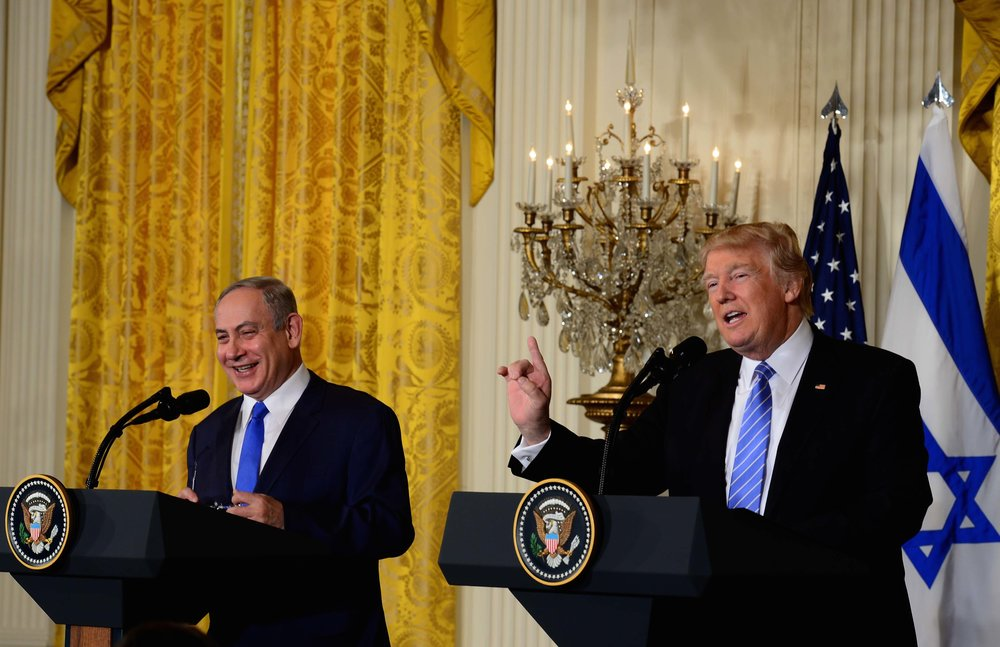 Prime Minister Benjamin Netanyahu (left) and President Donald Trump at their Feb. 15 joint White House press conference, during which Trump broke with the longstanding U.S. stance of wholeheartedly supporting the establishment of a Palestinian state. Credit: Avi Ohayon/GPO.