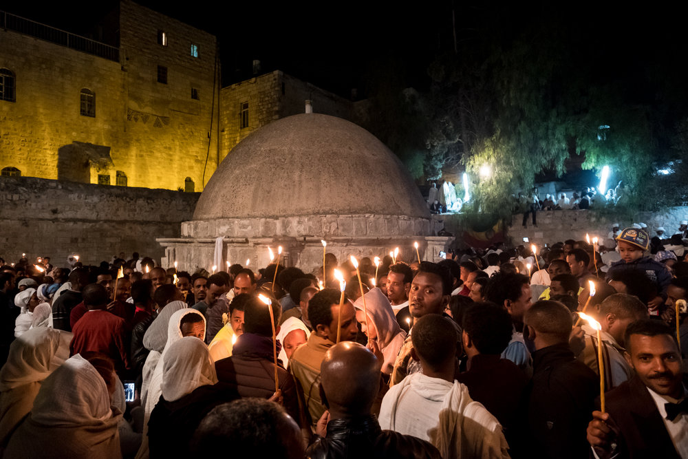 Ethiopian Orthodox Christians hold candles at the Church of the Holy Sepulchre during the Holy Fire ceremony in Jerusalem's Old City Saturday, April 15, 2017. Credit: Yaniv Nadav/Flash90.