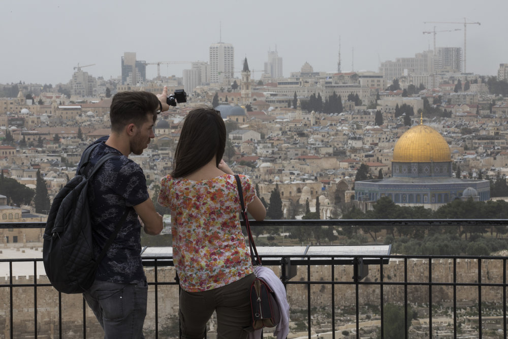 Visitors look towards the walls of the Old City of Jerusalem and the Dome of the Rock or Temple Mount, April 12 during Passover. Credit: Nati Shohat/Flash90.