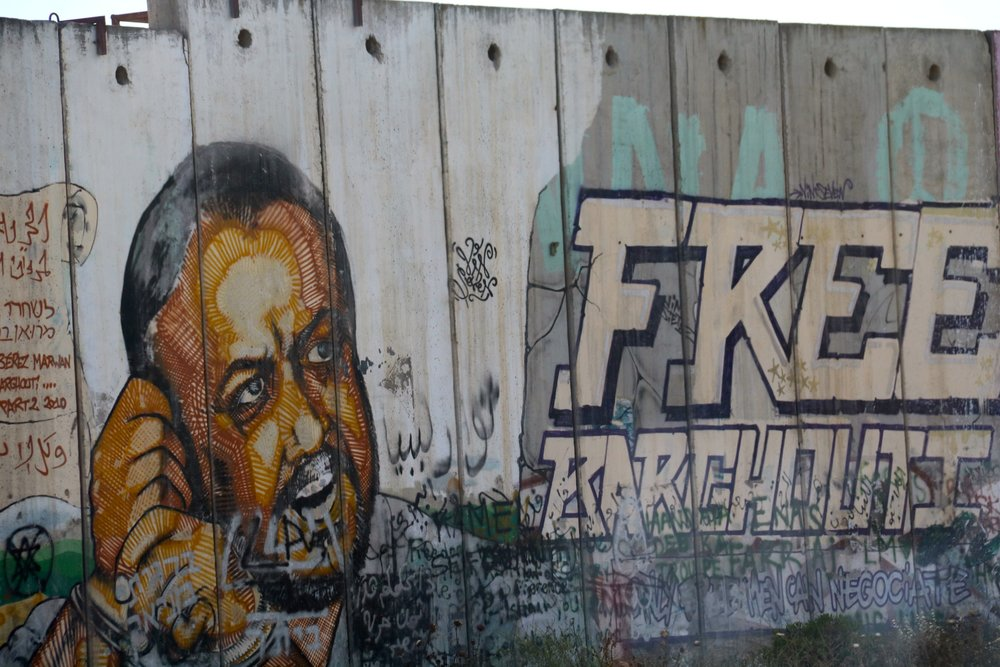 An image of Palestinian terrorist Marwan Barghouti, leader of the current hunger strike by Palestinian prisoners, painted on the security fence near the West Bank village of Qalandia. Credit: Haytham Shtayeh/Flash90.