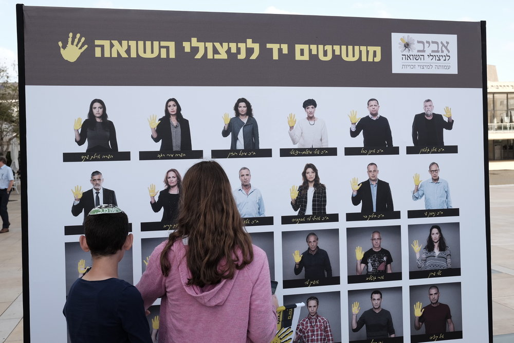 On Yom HaShoah April 23, 2017, Israeli youths visit a display in Tel Aviv that raises awareness about the living conditions of Holocaust survivors in Israel. Credit: Tomer Neuberg/Flash90.