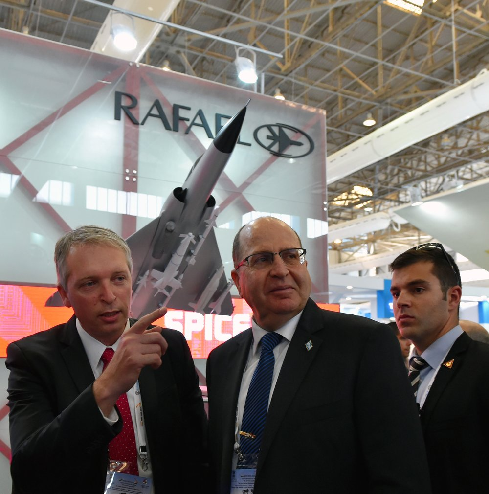 Moshe Ya'alon (center), then Israel's defense minister, visits a pavilion showcasing the Jewish state's defense industry during an arms fair in Bangalore, India, in February 2015. Credit: Ariel Hermoni/Israeli Ministry of Defense/Flash90.