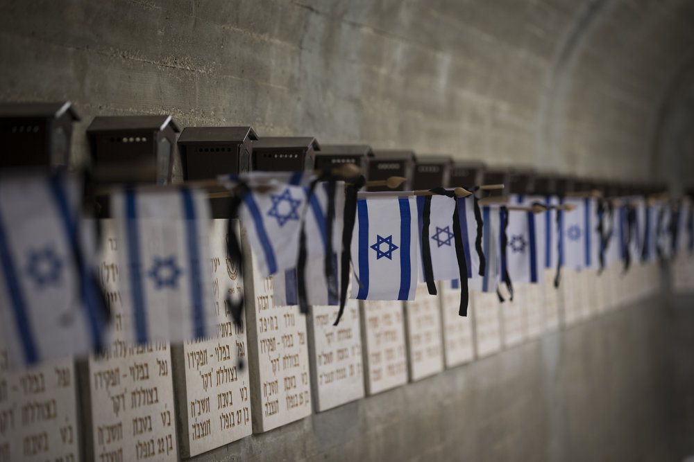 Small flags lay on graves of fallen Israeli soldiers at Mount Herzl Military Cemetery in Jerusalem April 27, ahead of Israel's Memorial Day. Credit: Yonatan Sindel/Flash90.