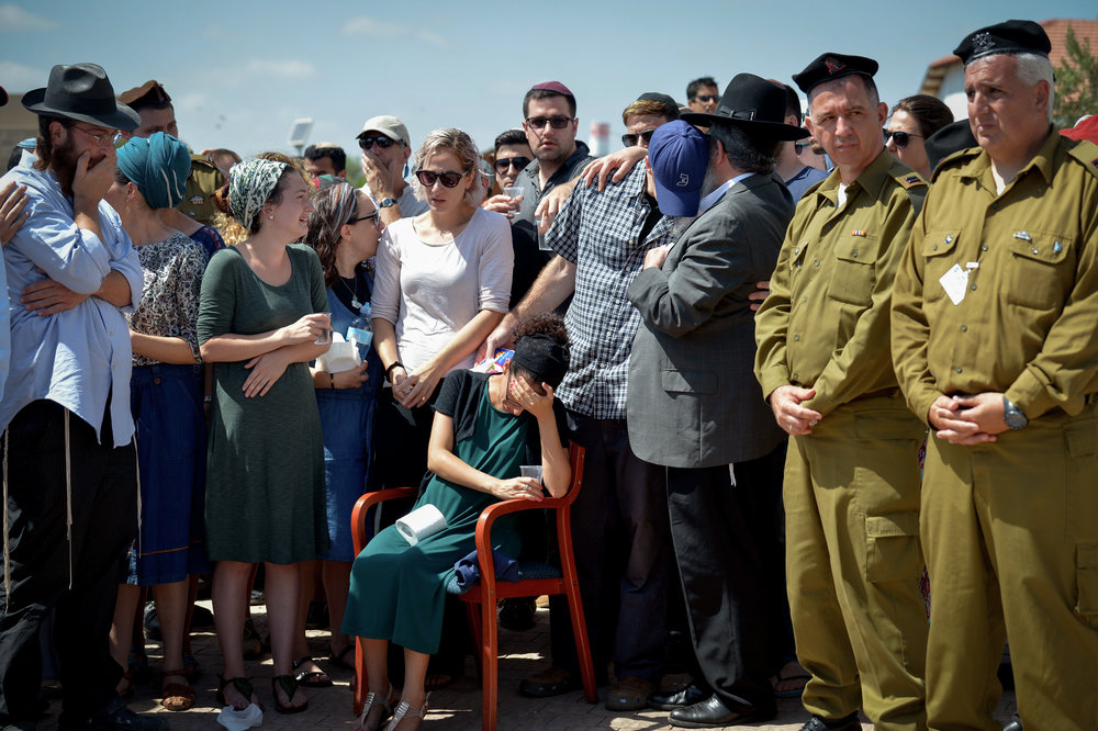 Family and friends mourn 20-year old IDF lone soldier Shlomo Rindenow at his funeral July 18, 2016. Rindenow was killed along with another Israeli soldier when a grenade accidentally exploded near an army post in the Golan Heights. Credit: Ben Drori/Flash90.