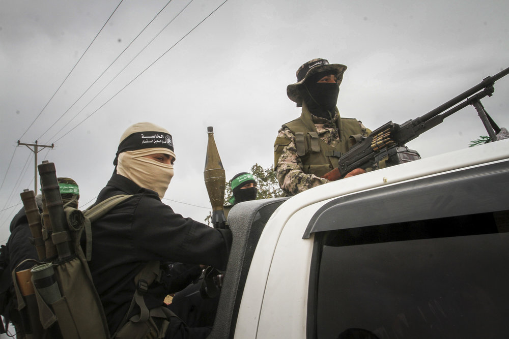 "Masked terrorists from the ""military wing"" of Hamas near the Israeli border with Rafah in southern Gaza, March 30. Credit: Abed Rahim Khatib/Flash90."