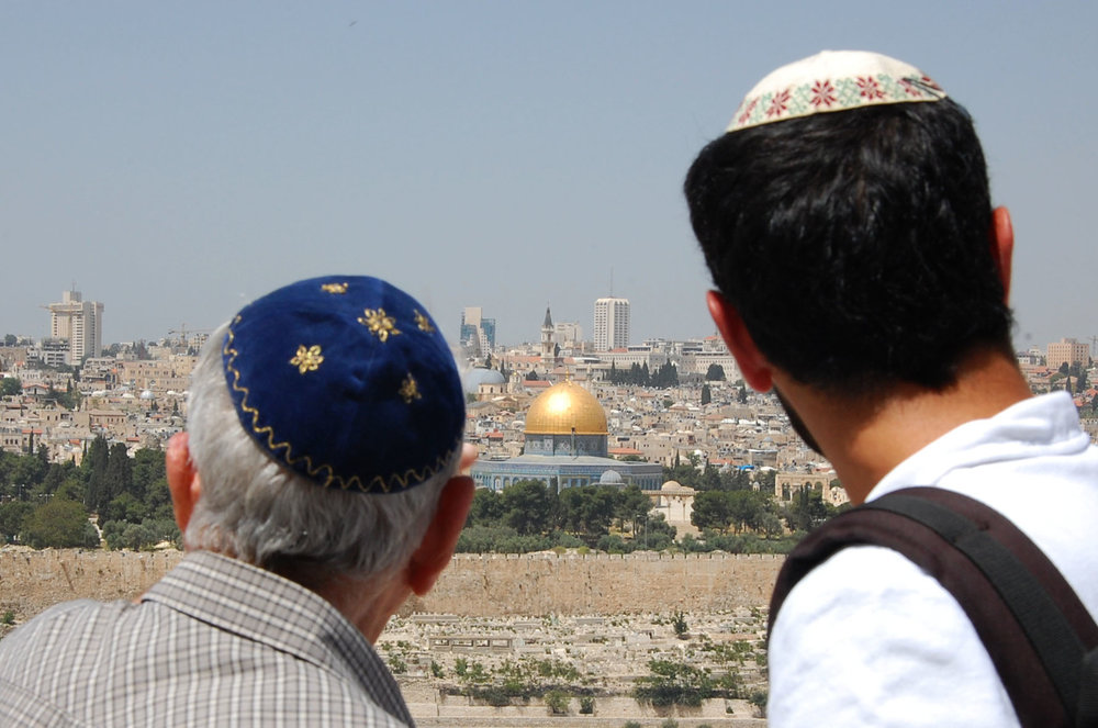 Two Jewish men look at Jerusalem's Old City, including the Temple Mount, from the Mount of Olives. Credit: Rachael Cerrotti/Flash90.