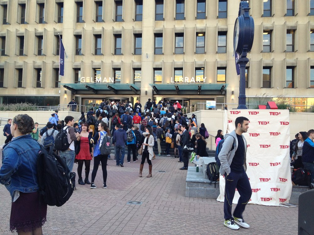 Students at Kogan Plaza, outside the Gelman Library, on the George Washington University campus. Credit: Wikimedia Commons.