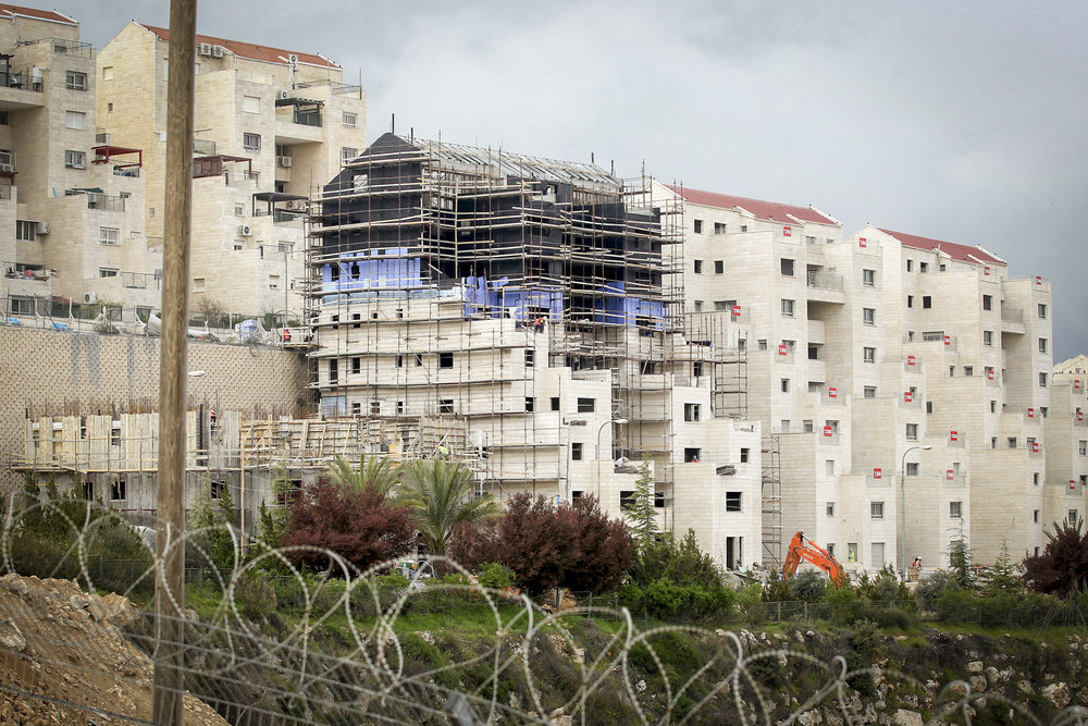 Construction in the Israeli settlement of Kiryat Arba, near Hebron, in April 2017. Credit: Wisam Hashlamoun/Flash90.