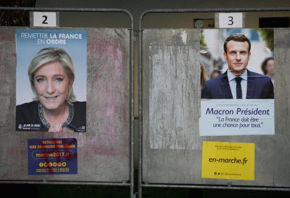 Posters showing French presidential candidates Marine Le Pen (left) and Emmanuel Macron outside a polling station in Cesson, France, April 23. Credit: Marion Sindel/Flash90.