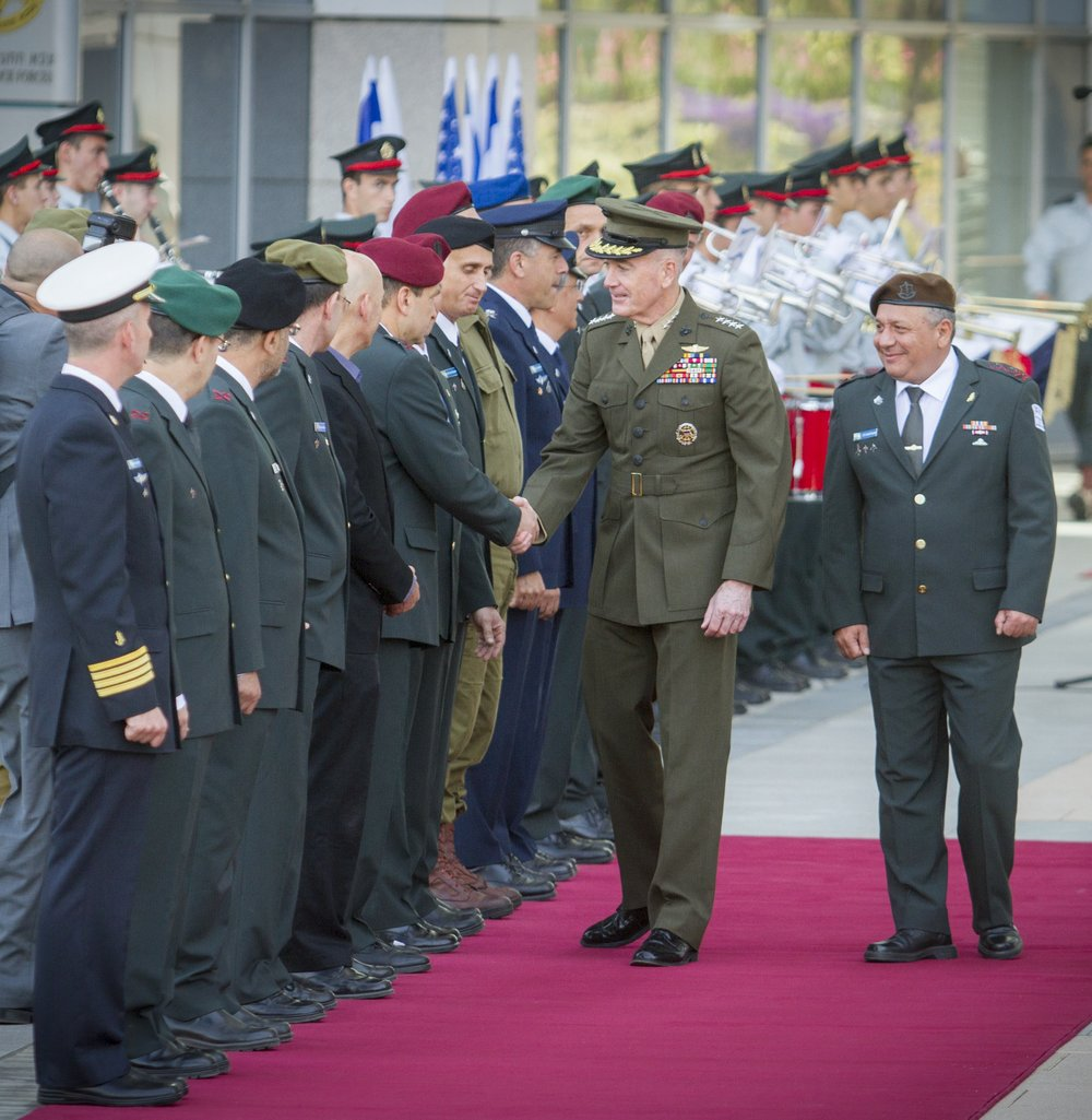 Israel rolls out the red carpet for U.S. Chairman of Joint Chiefs of Staff Gen. Joseph Dunford (pictured shaking hands) and IDF Chief of Staff Lt. Gen. Gadi Eizenkot (right) during an honor guard ceremony Tuesday in Tel Aviv. Credit: Flash90.
