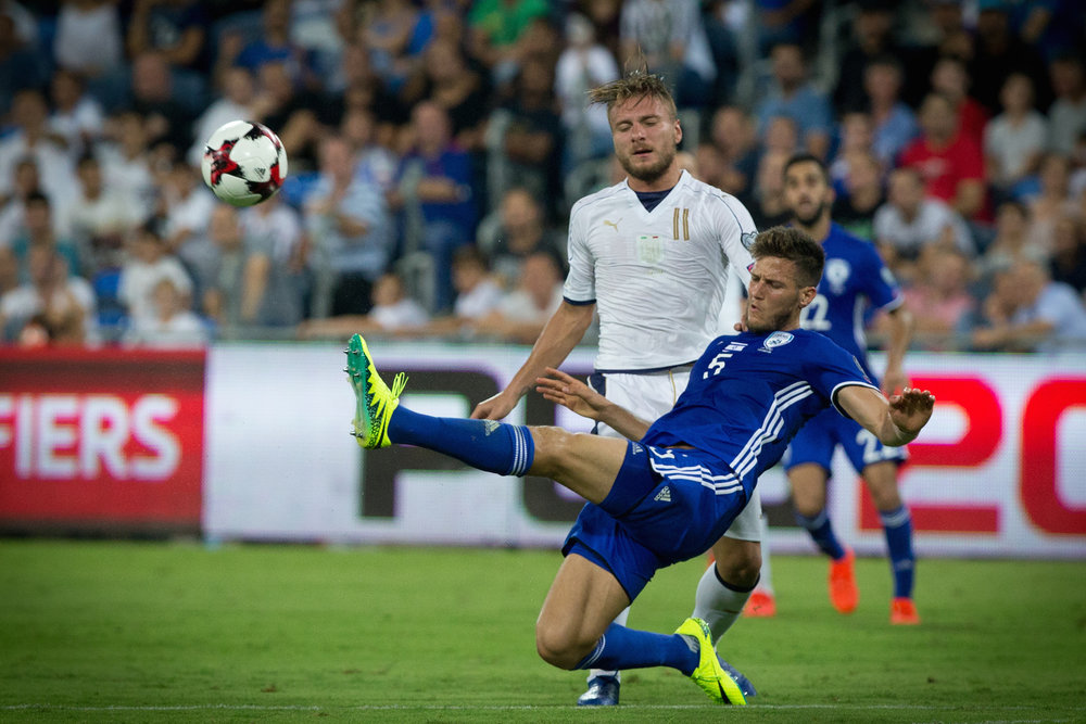 A FIFA World Cup qualifier match between Israel (blue uniform) and Italy at the Sami Ofer stadium in Haifa Sept. 5, 2016. Credit: Yonatan Sindel/Flash90.