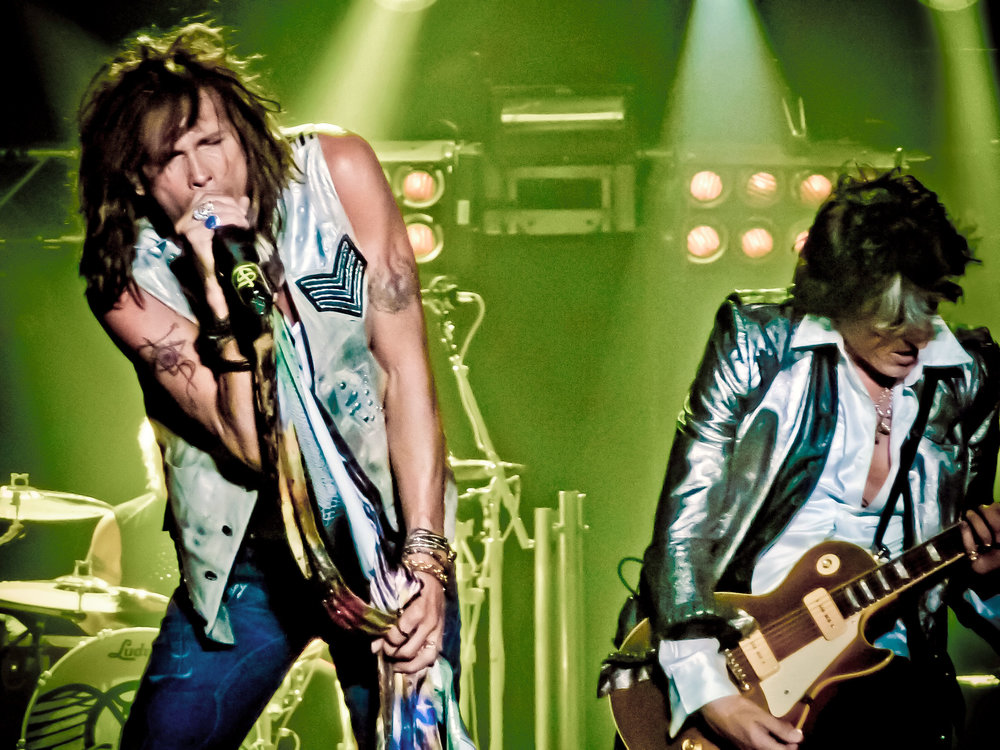 Aerosmith performs in the Netherlands in June 2010. Credit: Julio Aprea via Wikimedia Commons.