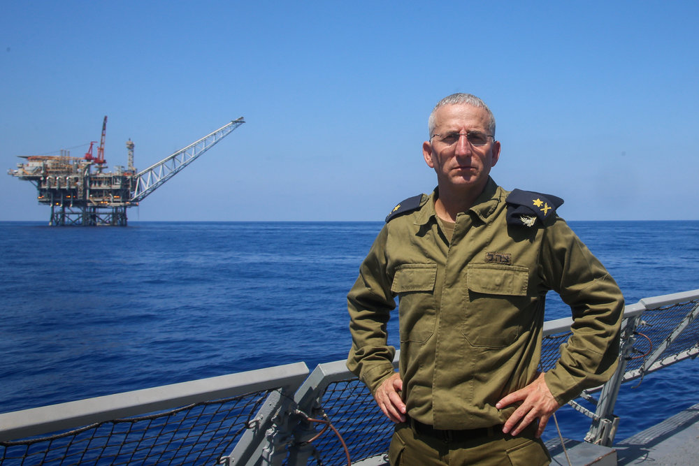 "Ram Rothberg, then the head of the Israeli Navy, poses near Israel's ""Yam Tethys"" offshore gas rig near the coast of Ashkelon, Sept. 2, 2015. Credit: Flash90."