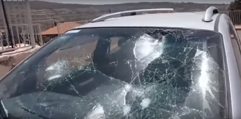 An Israeli man's car windshield, pictured here, was smashed by Palestinian rioters Thursday before the Israeli man shot and killed one of the attackers. Credit: YouTube.