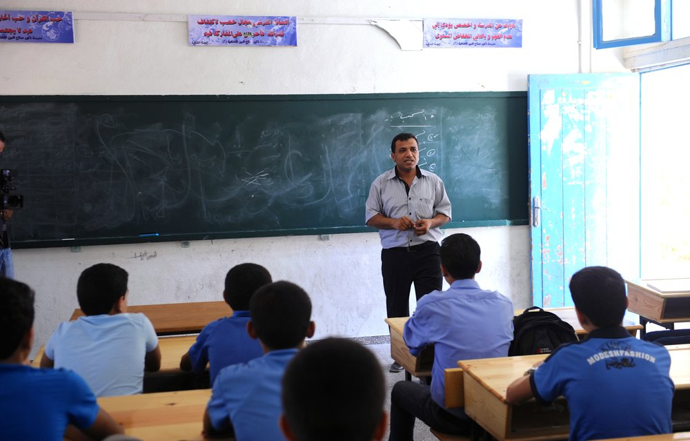 In September 2011, a teacher leads one of the first classes of the new academic year at a Gaza-based school supported by the United Nations Relief and Works Agency for Palestine Refugees in the Near East (UNRWA). Credit: UN Photo/Shareef Sarhan.