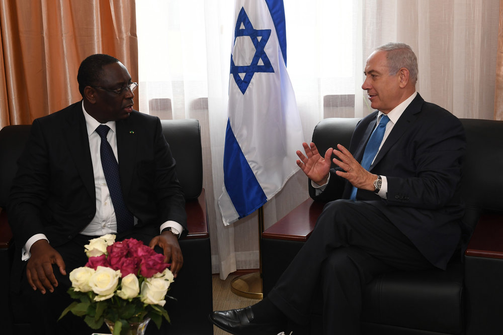 Israeli Prime Minister Benjamin Netanyahu (right) meets with Senegalese President Macky Sall on the sidelines of the Economic Community of West African States conference Sunday. Credit: Kobi Gideon/GPO.