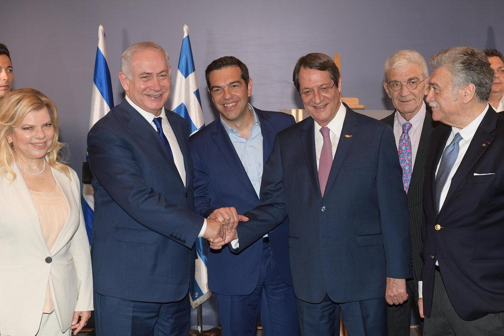 Sara Netanyahu, Israeli Prime Minister Benjamin Netanyahu with Greece's Prime Minister Alexis Tsipras (center) and Cyprus President Nicos Anastasiades. Credit: Amos Ben-Gershom/GPO.