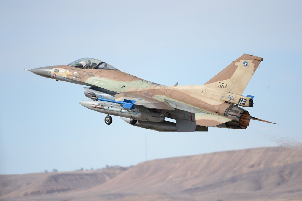 """An Israeli Air Force General Dynamics F-16C Barak jet of the 110th Squadron departs on a mission during the """"Blue Flag"""" international exercise at Israel's Ovda Air Base in November 2013. Credit: U.S. Air Force photo by Master Sgt. Lee Osberry."""