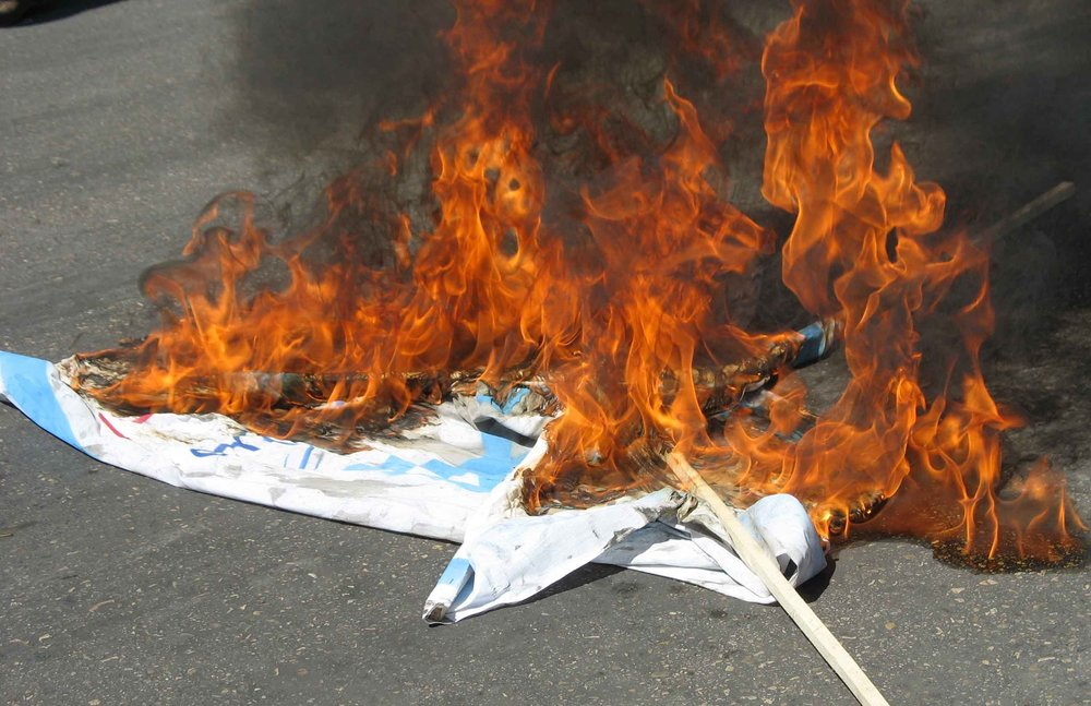 "The burning of Israeli flags during ""Al-Quds Day"" in Iran in 2011. Credit: Sonia Sevilla via Wikimedia Commons."