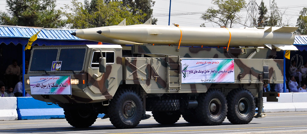 Iranian Fateh-110 missiles are showcased during an Iranian military parade in 2012. Credit: M-ATF via Wikimedia Commons.